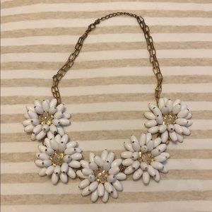 White flower necklace.